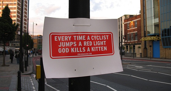 Every time a cyclist jumps a red light, god kills a kitten