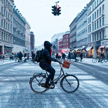 people cycling in icy weather